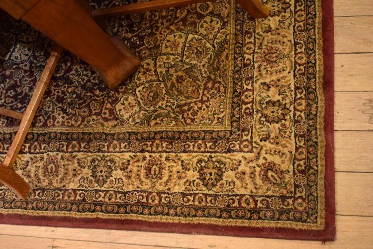 A TURKISH RUG IN RED TONES