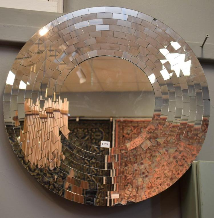 A MODERN CIRCULAR MULTISECTIONAL WALL MIRROR