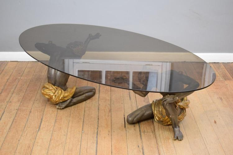 A BLACKMORES FIGURAL SMOKED GLASS COFFEE TABLE (some losses to base)