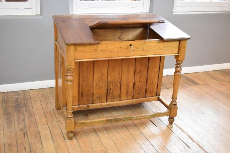 A 19TH CENTURY CEDAR AND PINE LIFT TOP CLERKS DESK (1m h x 1.2m w x 1.8m l)