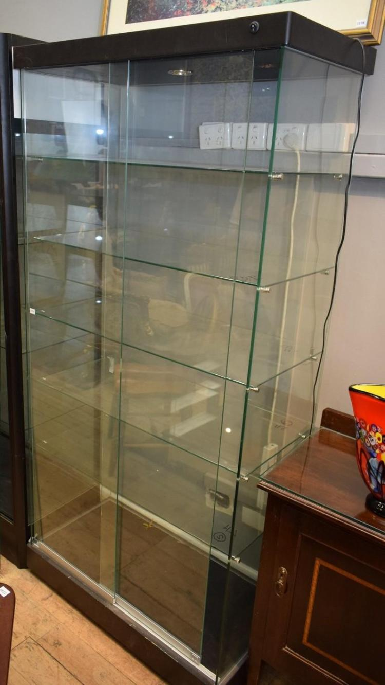A GLASS DISPLAY CABINET WITH LIGHT FITTINGS