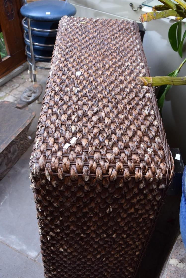 A LARGE WICKER OTTOMAN