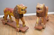 A PAIR OF EARLY 20TH CENTURY INDIAN HAND CARVED LIONS