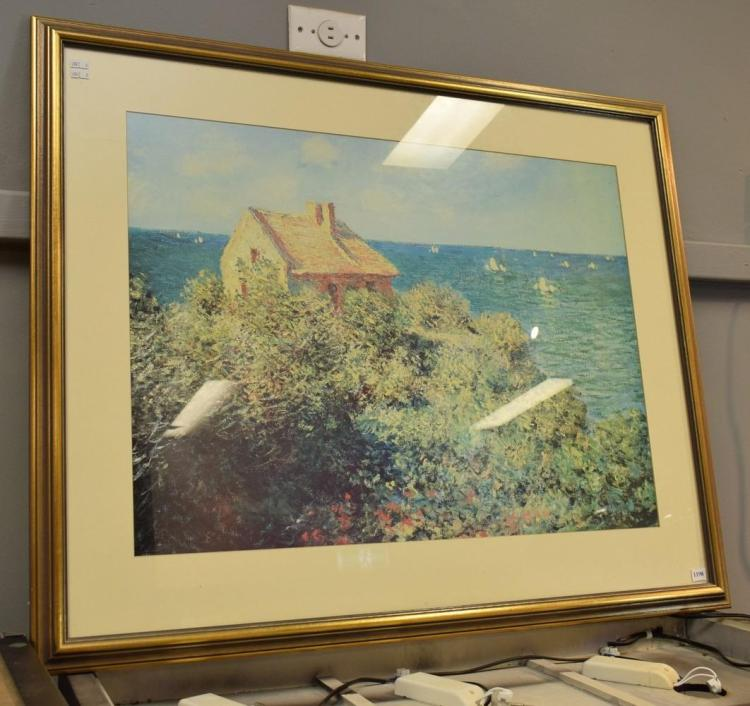 A GILT FRAMED PRINT OF A SEA SIDE VILLA