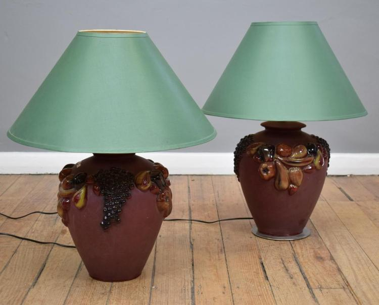 A PAIR OF TERRACOTTA LAMPS MOULDED WITH FRUIT
