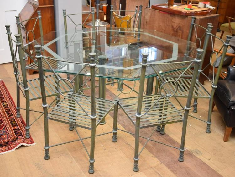 A NINE PIECE OCTAGONAL WROUGHT IRON GLASS TOP DINING SUITE (75cm h x 1.8m w)
