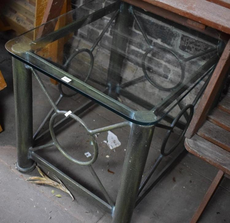 A PAIR OF WROUGHT IRON BASED GLASS TOP SIDE TABLES