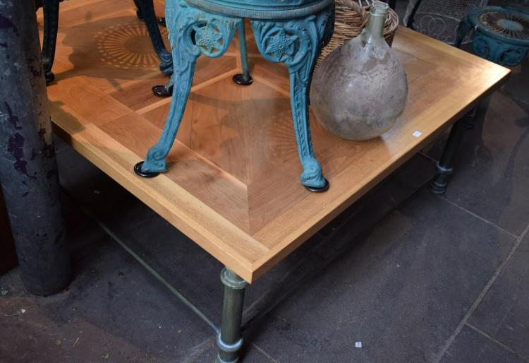 A PARQUETRY TOP COFFEE TABLE WITH A WROUGHT IRON BASE