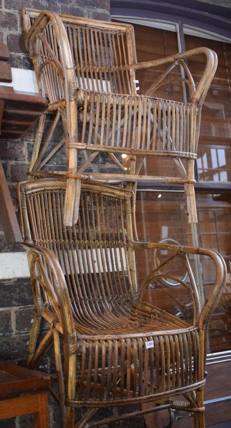 A PAIR OF CANE OUTDOOR CHAIRS