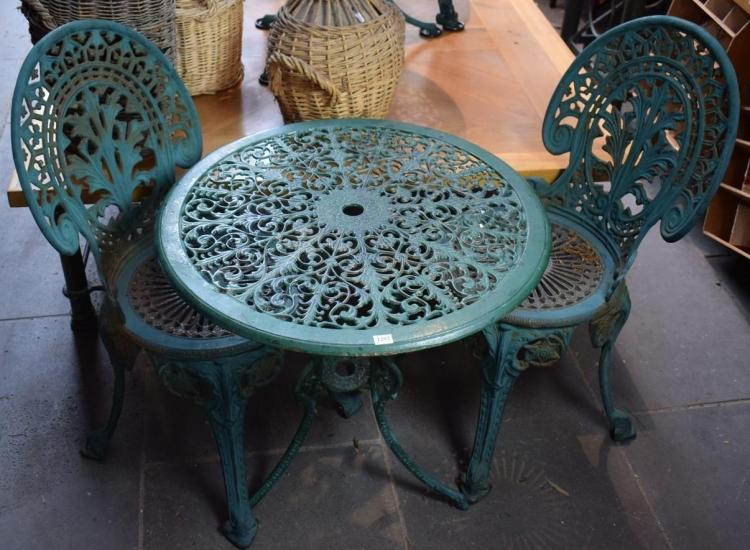 A THREE PIECE CAST IRON GARDEN SETTING