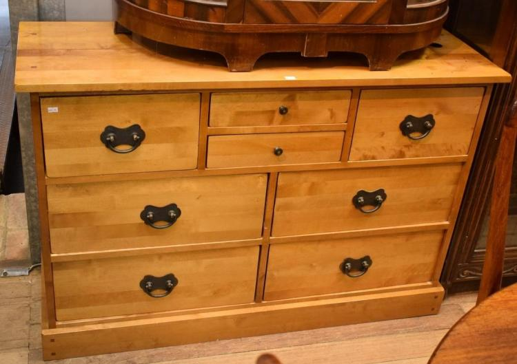 AN EIGHT DRAWER MAPLE CHEST OF DRAWERS