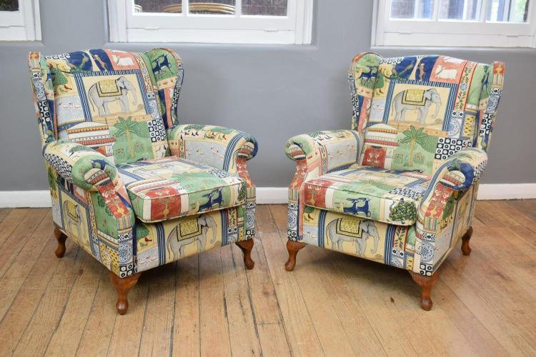 A PAIR OF QUEEN ANNE STYLE ANIMAL PATTERNED WINGBACK ARMCHAIRS
