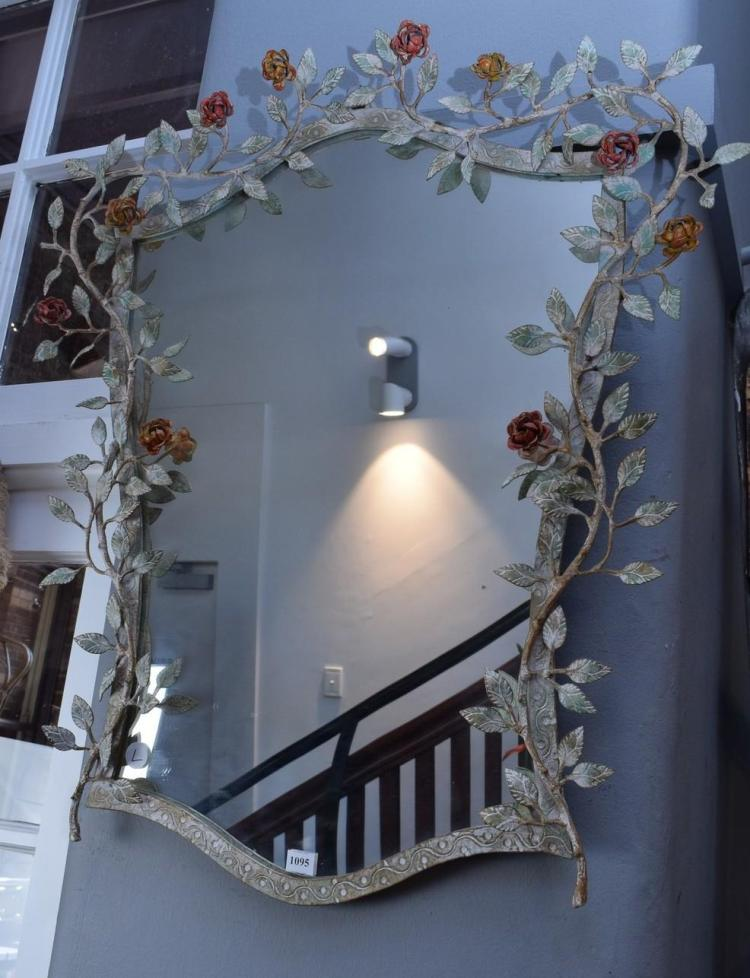 A DECORATIVE LEAF ADORNED WALL MIRROR