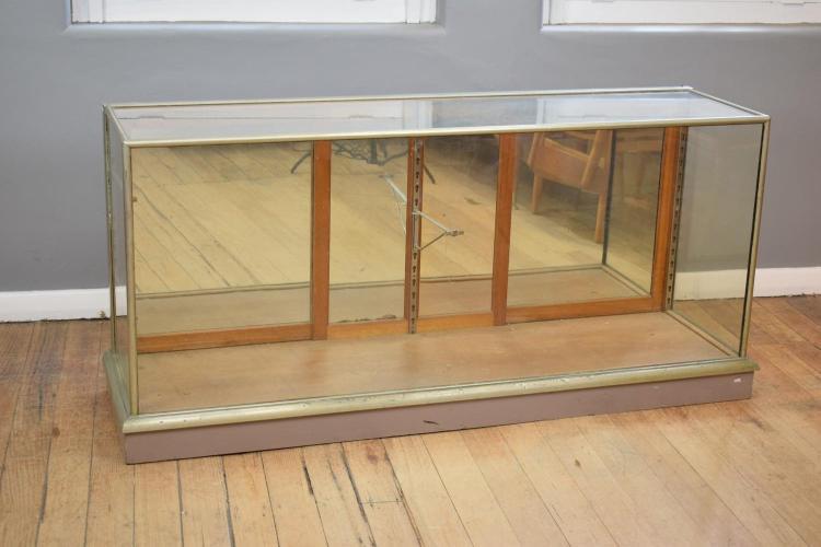 AN ART DECO CHROME BOUND GLAZED SHOWCASE (174cm w x 50cm d x 82cm h)