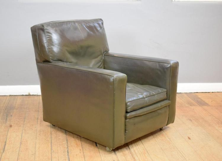 A VINTAGE LEATHER CLUB CHAIR