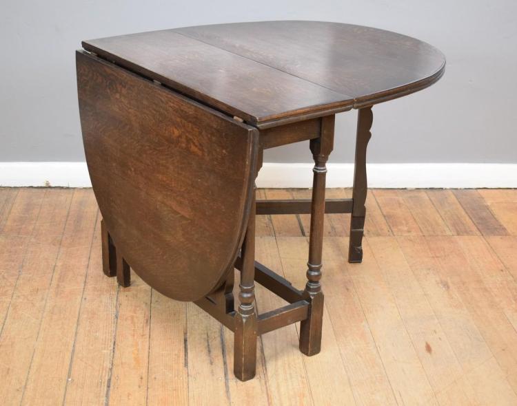 A JACOBEAN STYLE OAK DROPSIDE TABLE