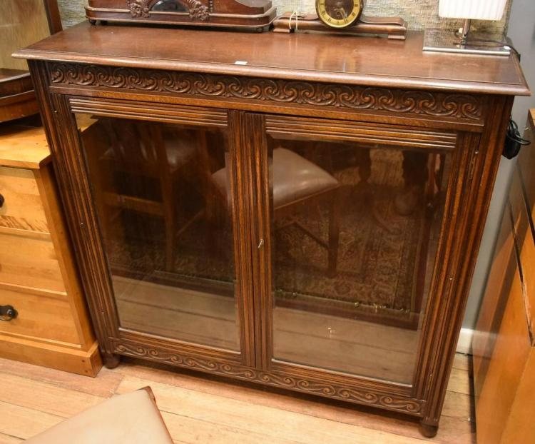 A JACOBEAN STYLE OAK DISPLAY CABINET
