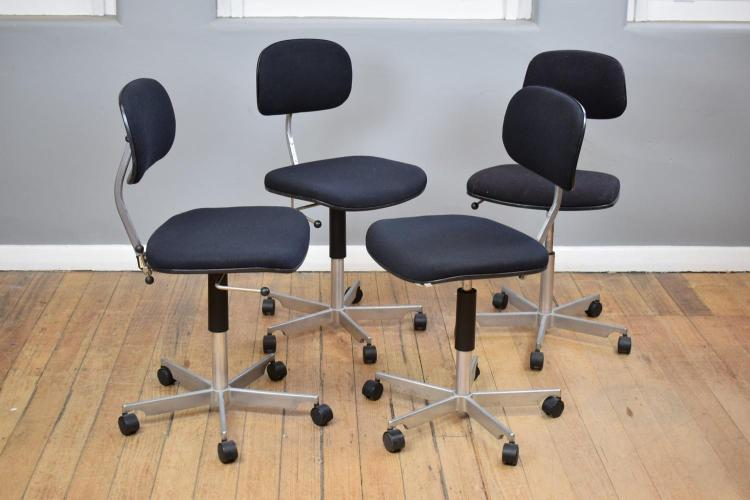 A SET OF FOUR 'KEVI' SWIVEL CHAIRS