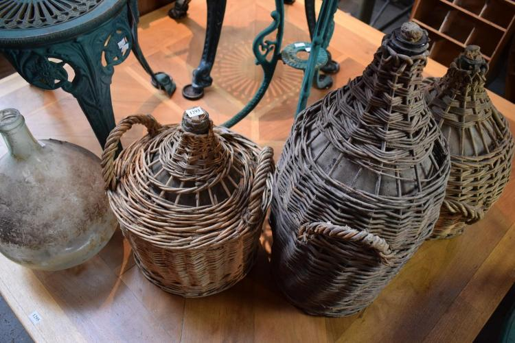 A COLLECTION OF CANE BOUND DEMIJOHNS