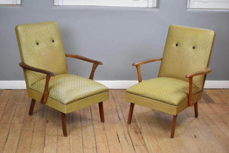 A PAIR OF MID-CENTURY VINYL ARMCHAIRS