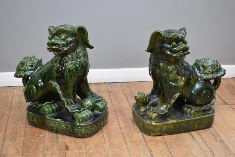 A PAIR OF CHINESE CERAMIC FOO DOGS - some losses