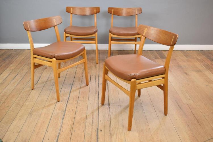 A SET OF FOUR HANS WEGNER CH23 CHAIRS BY 'CARL HANSEN'