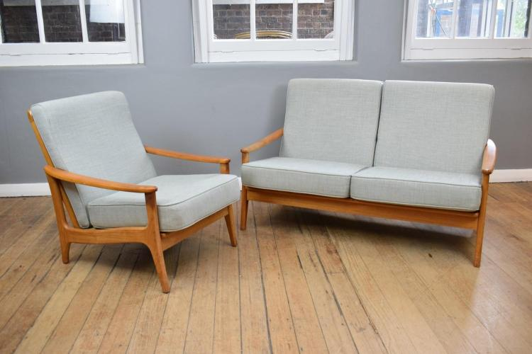 A DANISH STYLE THREE PIECE NEWLY UPHOLSTERED LOUNGE SUITE