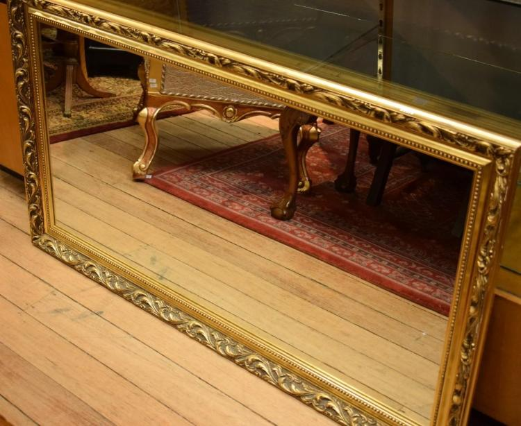 A RECTANGULAR GILT FRAMED MIRROR