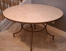 A MORROCAN CIRCULAR TILE TOP TABLE ON IRON BASE (77cm h x 1.4m d)