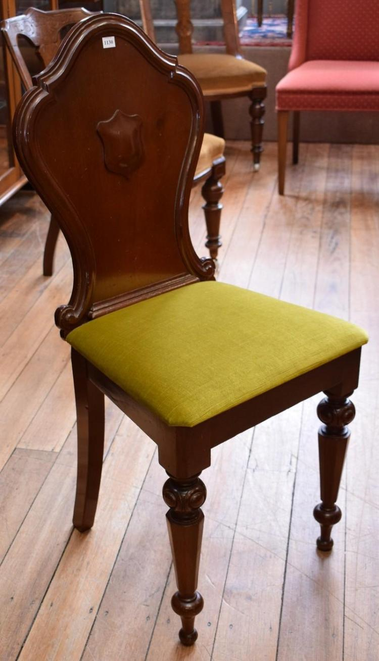 A PAIR OF VICTORIAN OAK SHIELD BACK HALL CHAIRS IN BRIGHT VELOUR