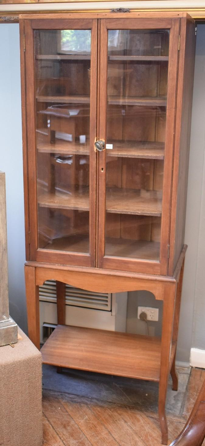 AN EARLY 20TH CENTURY TWO SECTIONAL GLAZED BOOKCASE CABINET (1.8m h x 64cm w x 43cm l)