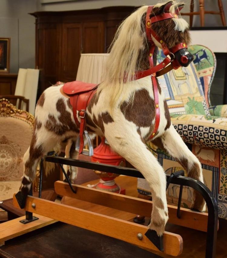 A VINTAGE ROCKING HORSE