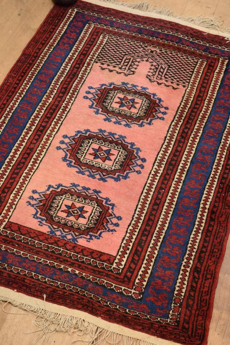 PAIR OF GEOMETRIC PATTERNED RED AND NAVY PRAYER RUGS