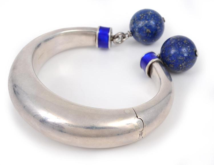 A SILVER , ENAMEL AND LAPIS LAZULI HINGED BANGLE BY GUCCI