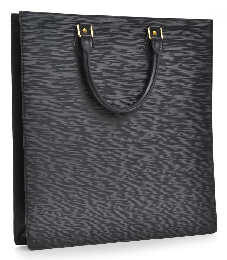 A SAC PLAT BAG BY LOUIS VUITTON