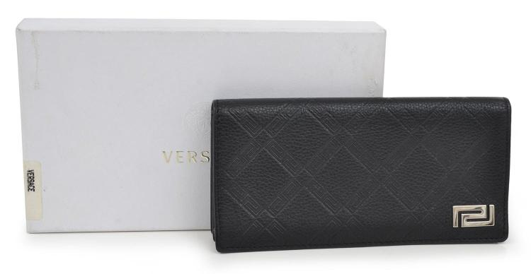 A LEATHER WALLET BY VERSACE