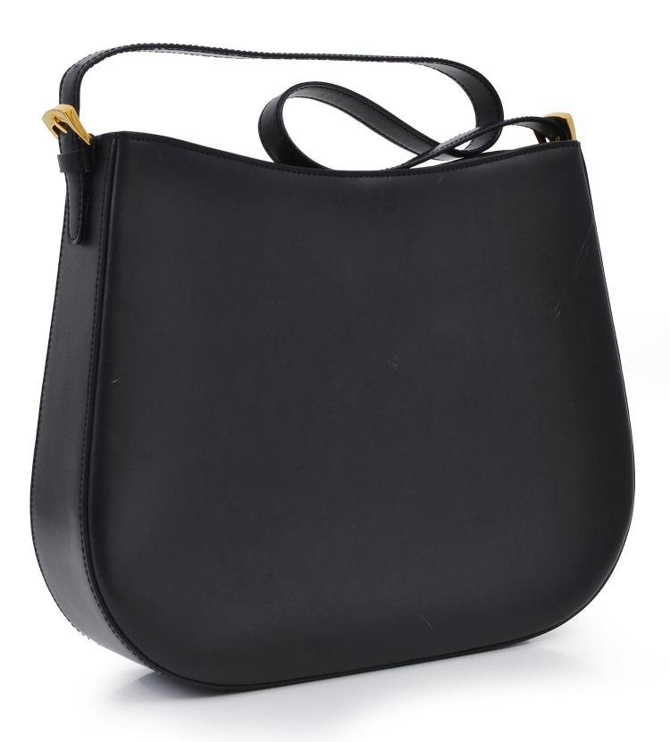 A HANDBAG BY CELINE