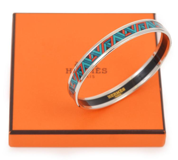 AN ENAMEL AND SILVER BANGLE BY HERMES