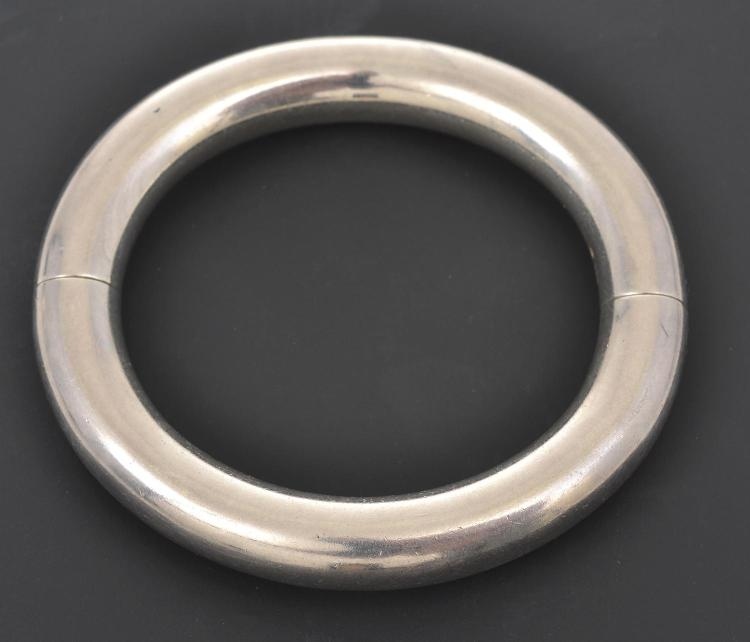 A SILVER HINGED BANGLE BY HERMES