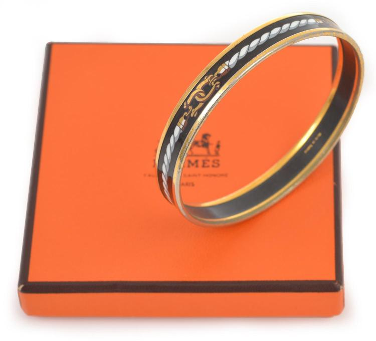 AN ENAMEL AND SILVER GILDED BANGLE BY HERMES