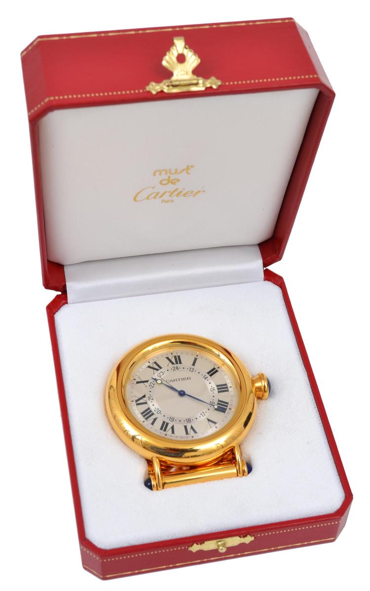 A TRAVEL CLOCK BY CARTIER