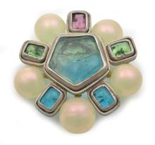 A BROOCH BY CHANEL