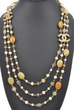 A BEADED NECKLACE BY CHANEL