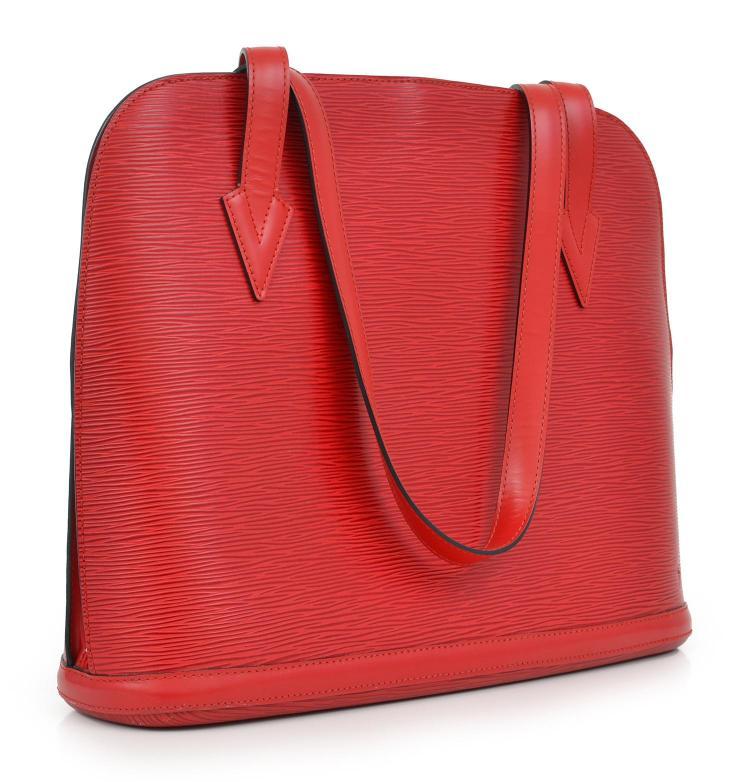 A LUSSAC BAG BY LOUIS VUITTON