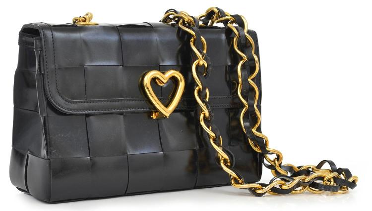 A HANDBAG BY MOSCHINO