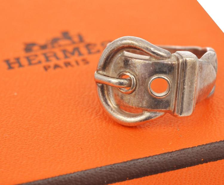 A VINTAGE BUCKLE RING BY HERMES