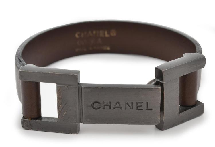 A LEATHER BRACELET BY CHANEL