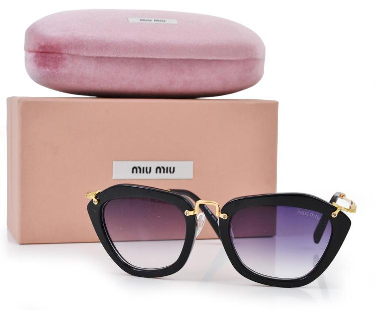 A PAIR OF SUNGLASSES BY MIU MIU