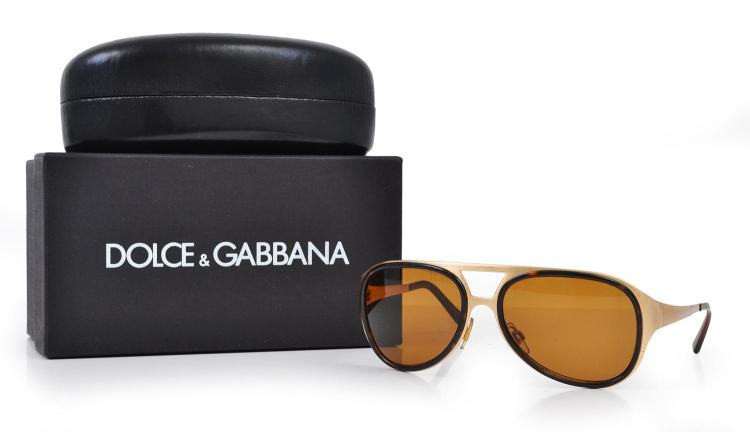 A PAIR OF SUNGLASSES BY DOLCE & GABBANA