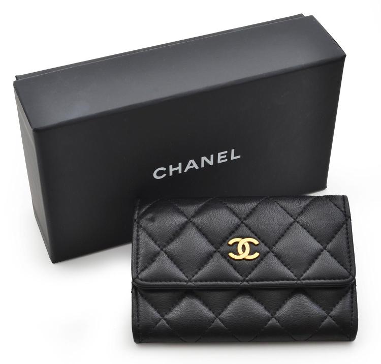A COIN PURSE BY CHANEL